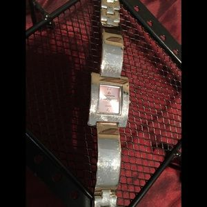Jewelry - Silver ladies oblong watch with a pink face.